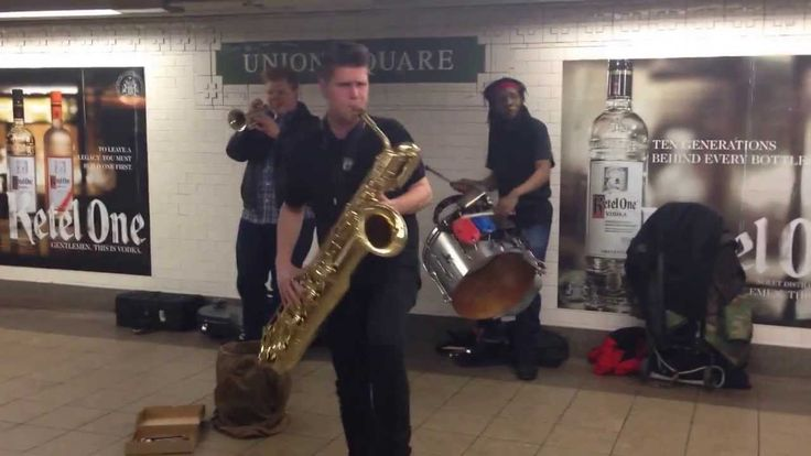 Too Many Zooz, A Powerful Horn-Based Trio, Performing in New York City's Union Square Subway Station