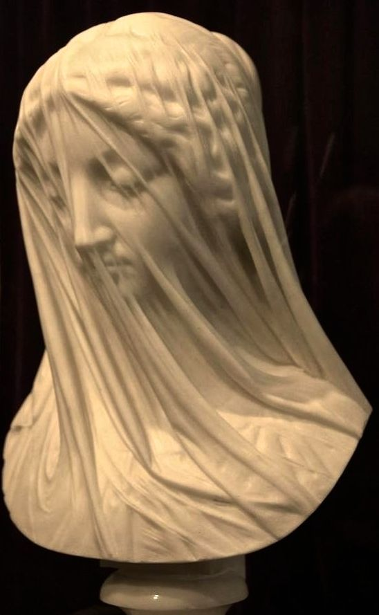"The Veiled Virgin is statue carved by Italian sculptor Giovanni Strazza (1818-1875), depicting the bust of a veiled Blessed Virgin Mary. This statue was executed in flawless Carrera marble by the renowned Italian sculptor in Rome. Other examples of Strazza's work may be seen in the Vatican Museums, Rome and in the city of Milan. The exact date of the statue's completion is unknown. (Wikipedia) (""The Veiled Virgin"" by Giovanni Strazza)"