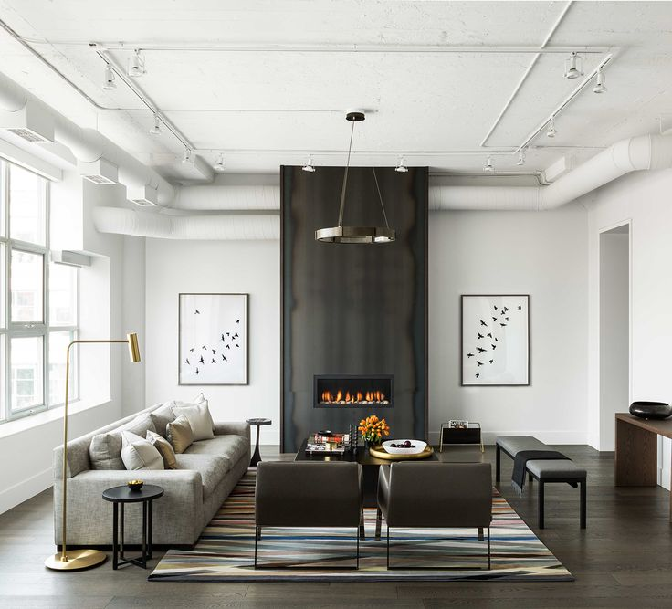 A Modern Industrial Loft in Toronto, contemporary living room, hot rolled steel floor to ceiling fireplace, design by Croma Design