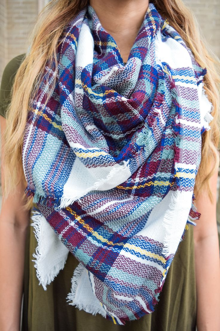 The blanket scarf of every girl's dreams!! This oversized navyåÊscarf is amazing for fall! The relaxed fringe edges looks amazing with the plaid print! The super soft texture is easy to style with all