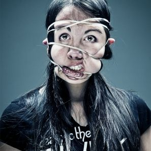 Wes Naman's Rubber Band portraits. Faces deformed with rubber bands. Delightfully odd.