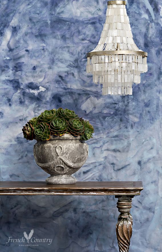 Opalescent shells juxtaposed with cool concrete textures and painterly finishes. An air of architectural design from traditional chic through to modern luxury.