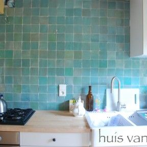 Zoek je tegels bij witte hoogglans keuken?
