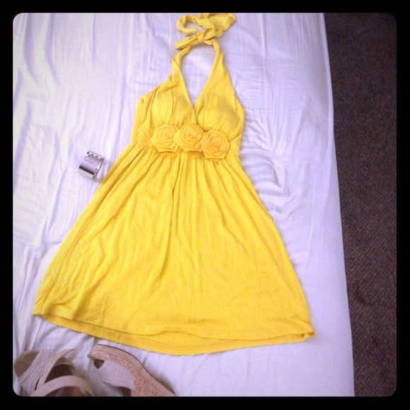 Yellow short dress with flowers For FREE SHIPPING go to my merc.. website. My closet > about > website.. Yellow small dress/ new without tag Dresses