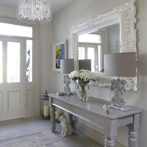 Gorgeous! Love the gray table, the over sized mirror, the lamps