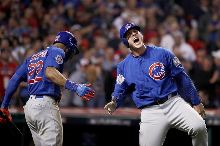 CLEVELAND, OH - NOVEMBER 02: Anthony Rizzo #44 of the Chicago Cubs celebrates with Jason Heyward #22 after Rizzo scores a run in the 10th inning on a Miguel Montero #47 against the Cleveland Indians in Game Seven of the 2016 World Series at Progressive Field on November 2, 2016 in Cleveland, Ohio.  (Photo by Ezra Shaw/Getty Images)
