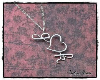 Introducing Silver Ink, my exclusive style of personalized jewelry, like traditional wire name jewelry, but with sculpted calligraphy script letters. Each letter is forged, then soldered to create a solid piece of sterling silver. Designed here in my Independence, MO studio, this style of forged wire writing is protected by US copyright laws, so you will only find it here at SilverTrove!  This single capital letter initial pendant comes on a delicate sterling silver drawn cable chain with a…