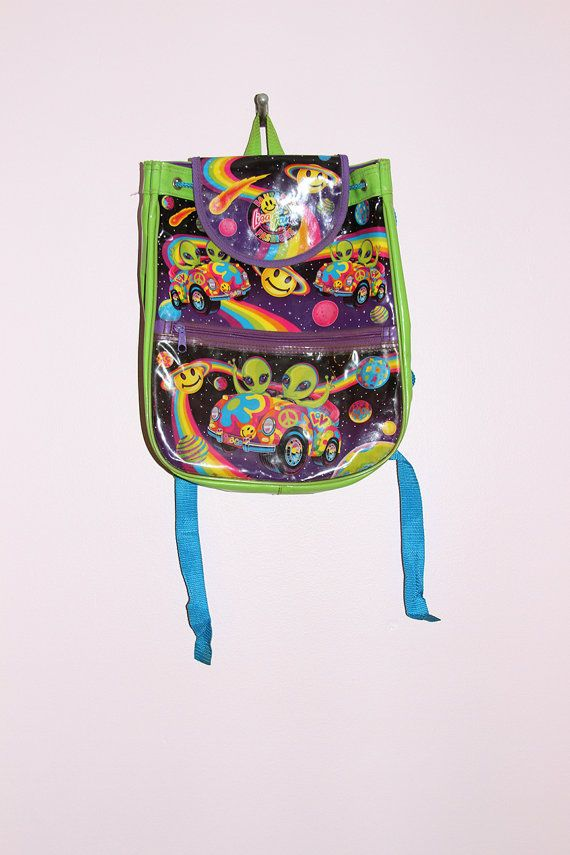 Super awesome vintage Lisa Frank alien backpack! Backpack has one large drawstring closure pouch with flap and one smaller zipper pouch in front with