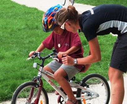 Bicycle Instructor teaching kids how to ride. Bike On NZ Trust