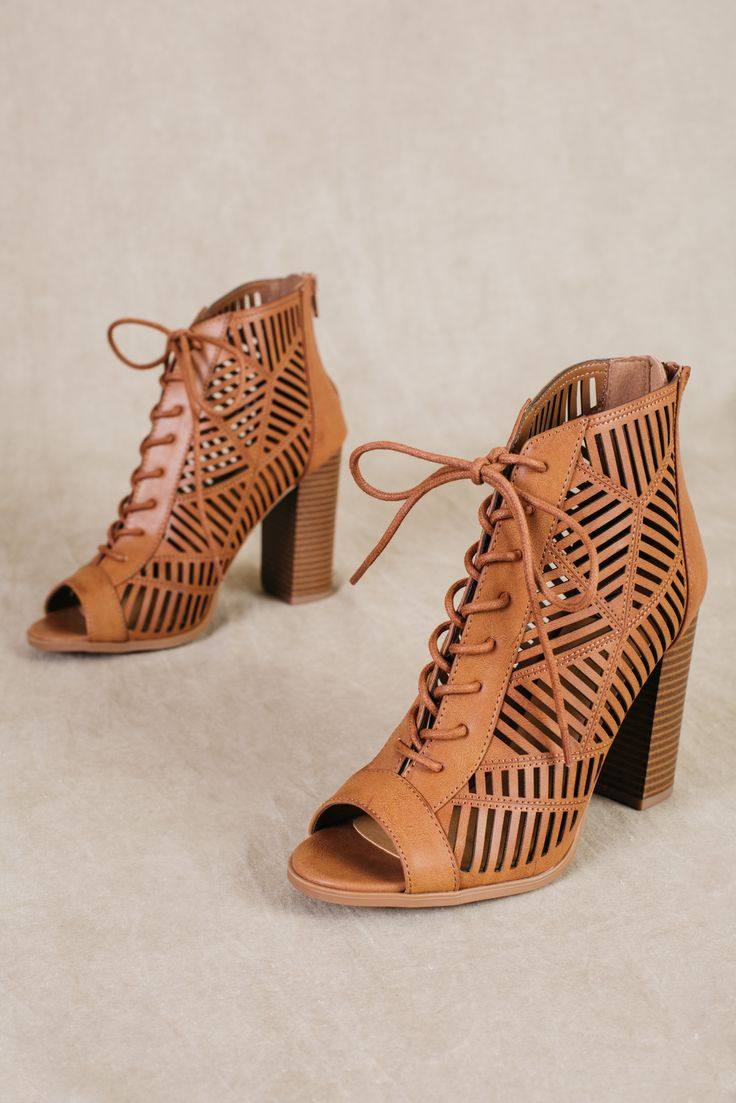 We are obsessed with these new Message Dress Sandals from Delicious! These vegan leather peep toe heels feature a laser cut design, adjustable laces and zip in back! These heels are perfect for a nigh
