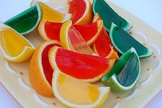 Awesome Jello Fruit idea! Simply cut an orange in half, scoop out the fruit (eat it, of course), then fill the hollowed rind up with jello and let it do its thing! Then cut out normal wedges for an awesome looking treat! sounds good to me.