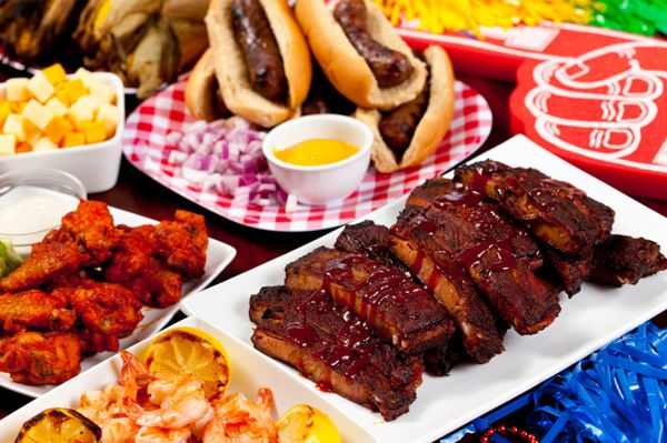 Chicken wings, ribs, shrimp, sausage and hot dogs are all a must have tailgating food. #EsuranceFantasyTailgate
