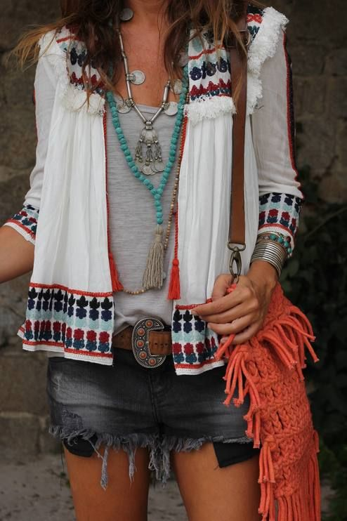 Mytenida is rocking this outfit. Love the distressed denim mini, fringed orange cross body & ethnic inspired jacket.