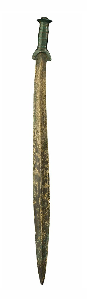 A EUROPEAN BRONZE SWORD   SOUTH-CENTRAL EUROPE, LATE BRONZE AGE, CIRCA 11TH CENTURY B.C.   The lanceolate blade with a raised rounded midrib, tapering to the sharp cutting edges, with an incised linear border along its length, inserted into the separately-cast hilt, with two rivets joining the arched guard to the blade, the grip with four raised bands, each flanked by incised bands, the disk-shaped pommel with a terminal knob, incised concentric circles on the top