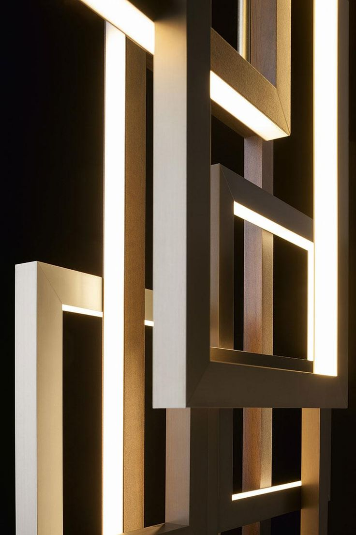 Detail of the Edge suspension lamp by Oasis, design by Massimiliano Raggi. LED lights diffused by a structure of aluminum, bronze and antiqued gold.