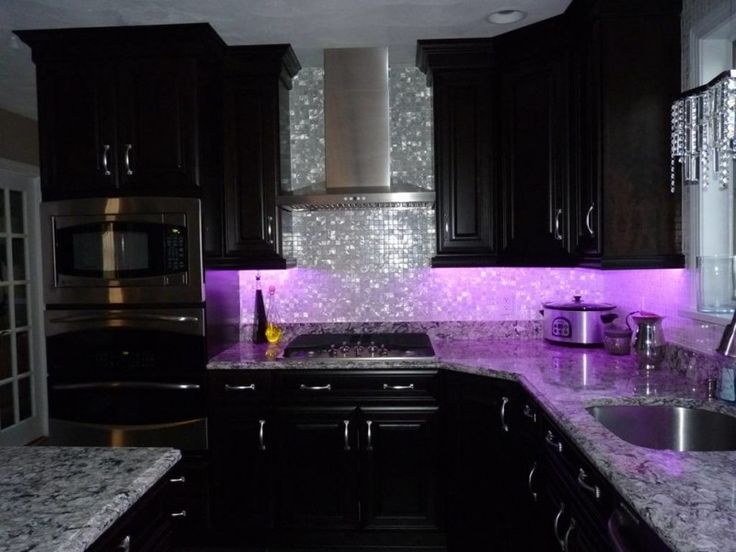 luxurious and glamourous kitchen idea with shiny purple ambiance glowing silver toned backsplash black painted cabinets marble countertop stainless steel appliances of 50 Inspiring Purple Theme Colour for Kitchen