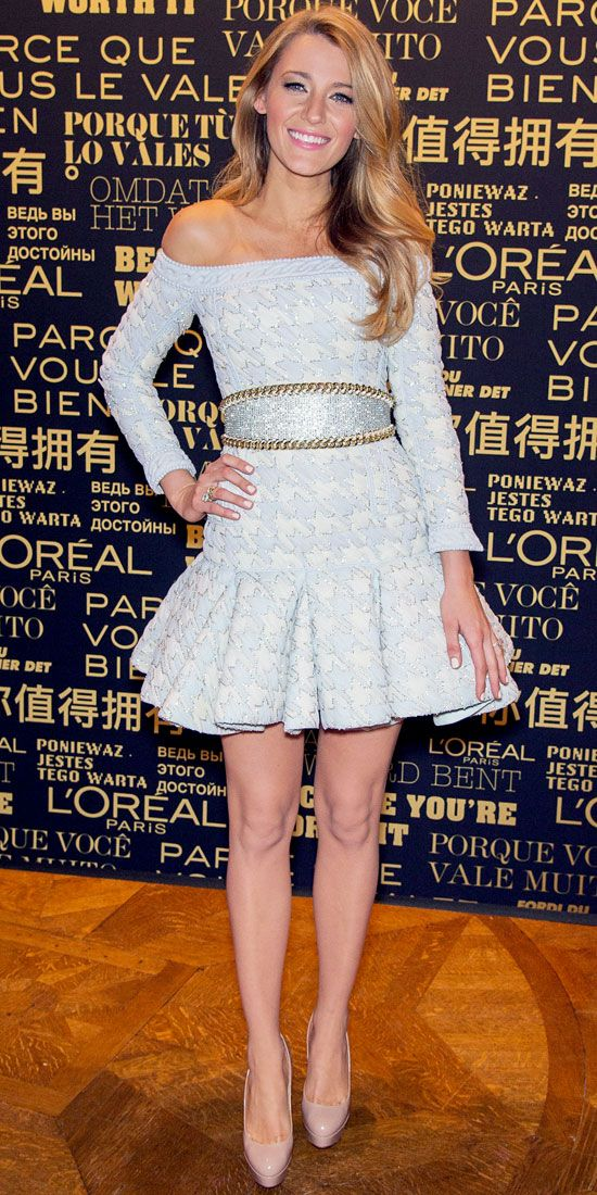 As the newest face of L'Oreal Paris, Blake Lively chose French brand Balmain for the announcement, wearing an off-the-shoulder pale boucle houndstooth flared dress with a chain-lined silver belt and nude pumps.
