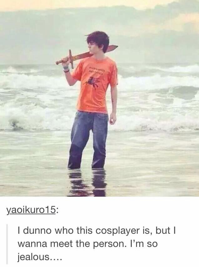 But no his hair is wrong and the sword is obviously plastic and the Camp Half Blood shirt is in Greek and the Pegasus on it is too detailed and he is wet and that can't happen to Percy and where is the bead necklace and I'm pretty sure that even if that was him he wouldn't be spending his valuable time standing knee length in the ocean staring into nothingness.