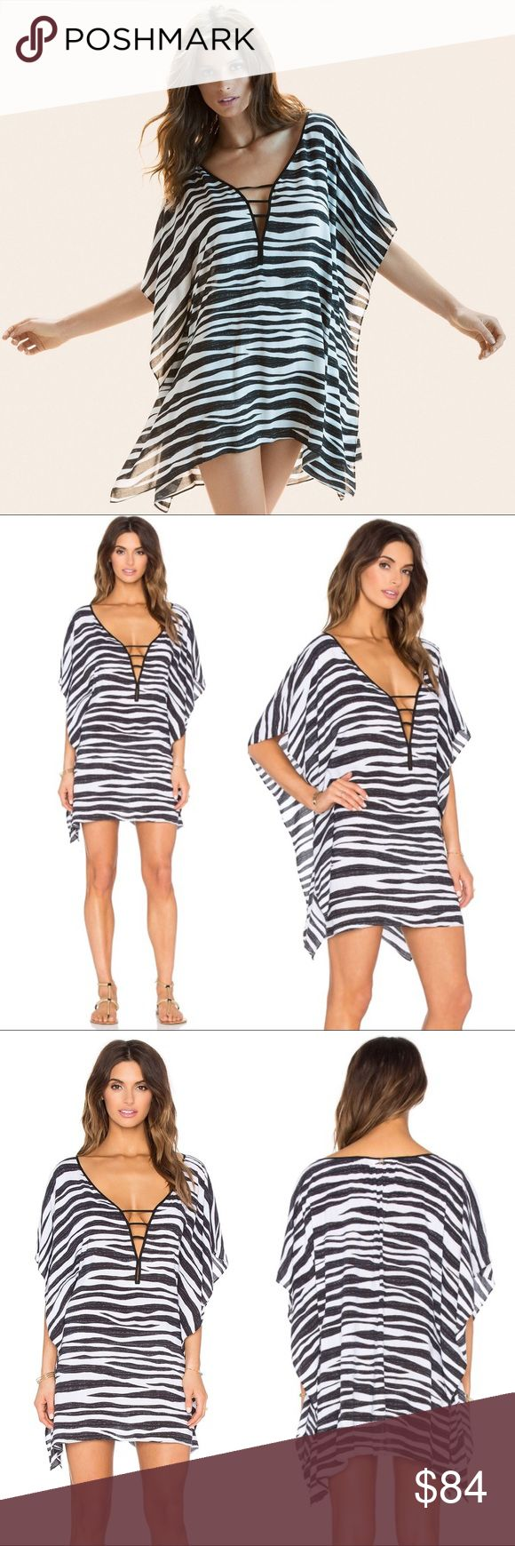 """👣🆕 Vix ✦ Camila Kimono Caftan ✦ Zebra Print Vix Camila Caftan in Zebra Print Brand New with Tags in Manufacturer's Packaging  👣👣👣👣👣👣👣👣👣👣👣👣  Head from beach to boardwalk in this chic zebra striped beach dress designed with a plunging neckline and flowy kimono sleeves. Luxurious elegance! Pair with bare feet or with your sexiest gladiators.   Approximate Measurements:  Length: 32"""" Fabrication: 100% Rayon/Viscose   👣👣👣👣👣👣👣👣👣👣👣👣  ✗ Drama ✗ Trades ⚡️Fast Shipper ☆☆☆☆☆ 5…"""