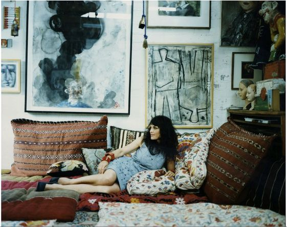 Loving the juxtaposition of harder edged abstract art on the walls and soft, oversize pillows on the ground.