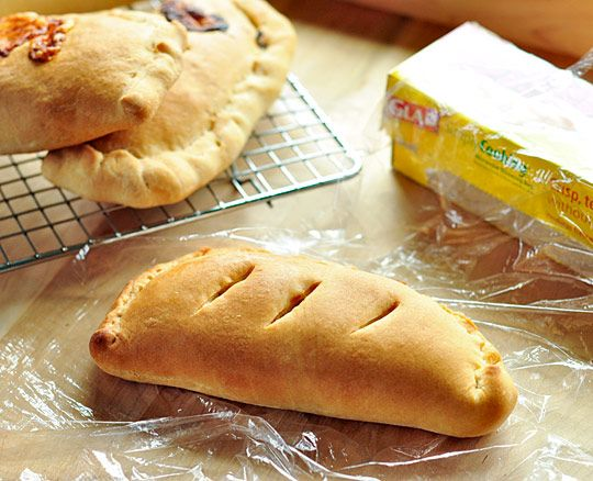 "Calzones are a favorite for wrapping up, freezing, and eating for lunches all week long. Lunch or dinner, they're the perfect little ""hot pockets"" (ahem!) of cheese, veggies, and leftover meat. Here's how to make them."