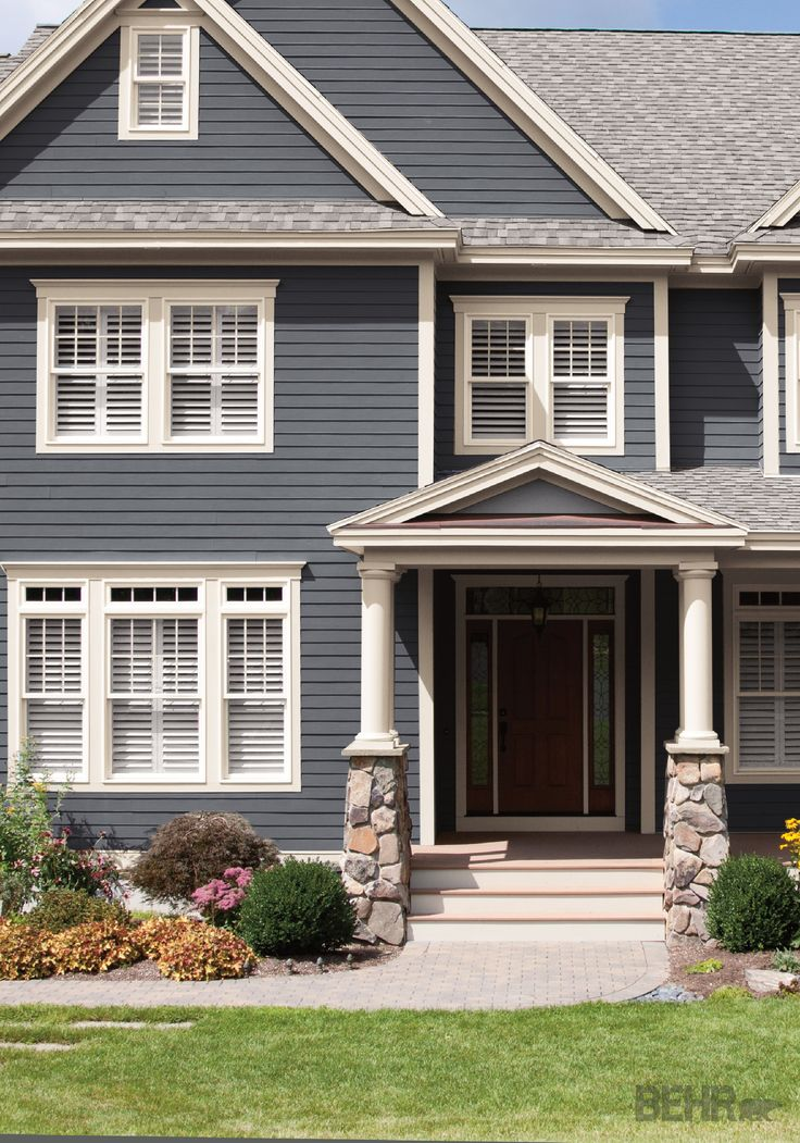 Give your exterior the feel of a stately coastal home with a curb appeal makeover when you for Blue grey exterior house paint