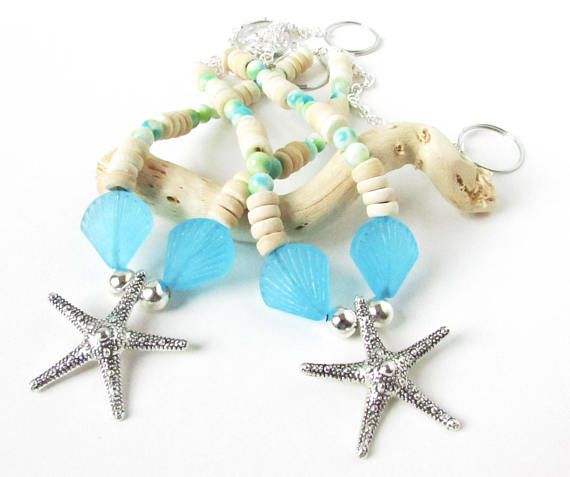 These starfish curtain tiebacks are perfect for a beach cottage home decor. A pretty way to add some coastal decor. These starfish curtain tiebacks have a starfish focal pendant in the center. There are pretty cultured sea glass crystal beads along with natural coconut shell beads
