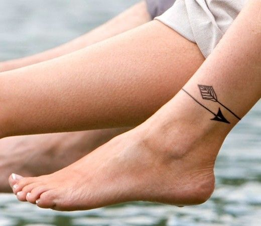 small arrow tattoo on ankle