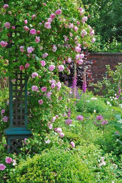 Gorgeous English Country Garden with turquoise lattice