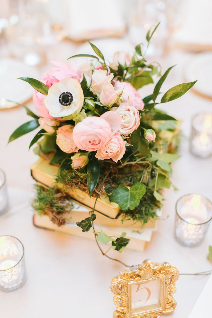 Vintage Book and Pink Ranunculus Centerpieces | Julie Lim Wedding Photography https://www.theknot.com/marketplace/julie-lim-wedding-photography-montrose-ca-764712 | NOLO Weddings & Events | The Floral Studio