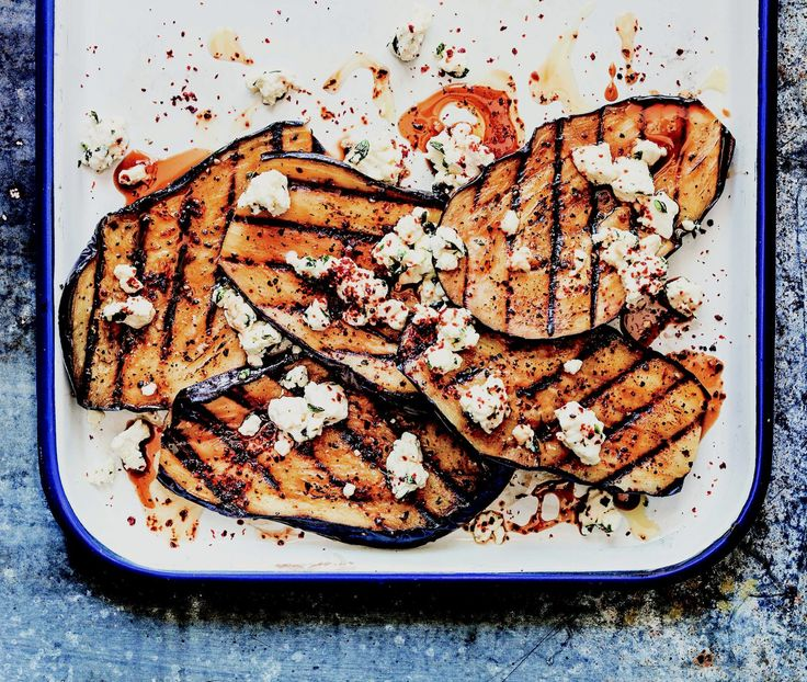 Grilled Eggplant With Feta And Pomegranate Molasses - Eggplant is big in Middle Eastern cuisines, so here we combine it with several of our favorite flavors from that part of the world. If you've never used them, Maras peppers and pomegranate molasses are both well worth searching out.  http://www.foodrepublic.com/recipes/grilled-eggplant-with-feta-and-pomegranate-molasses-recipe/