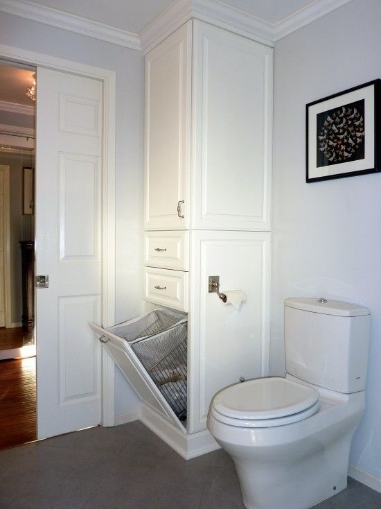built in laundry basket inside the cupboard (idea only, colour/design to match bathroom)