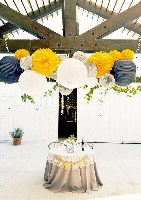 yellow blue paper lanterns wedding decor / http://www.himisspuff.com/100-charming-paper-lantern-wedding-ideas/6/
