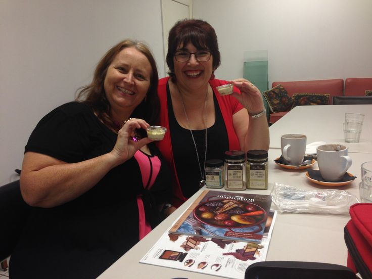 Karen Roope from Your Inspiration at Home showing Anne Frodl from Intimo, some yummy Lemon Myrtle cheesecakes that she made for us to enjoy at Connect Circles.