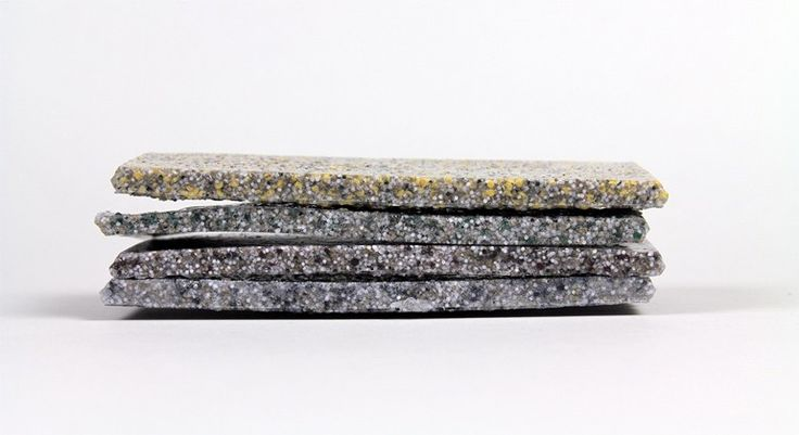 Composite material made from recycled waste leather and binders with a stone-like appearance. Through research and practical experimentation have developed two forms of material