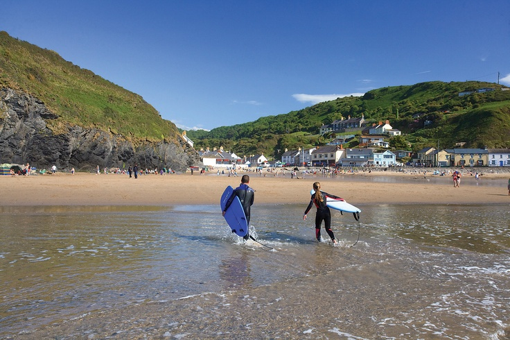 Surfers on Llangrannog Beach on the Ceredigion Coast. Image rights: FBA Group http://www.fbagroup.co.uk/