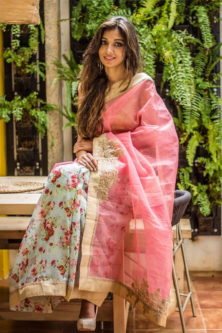 A brunch outing made easy as this half-and-half has it all - print, pastels and panache. A muted gold border to give enough room for oomph, this saree can keep your dress up worries at bay for several occasions. #pink #floral #halfandhalf #semisilk #saree #India #blouse #houseofblouse