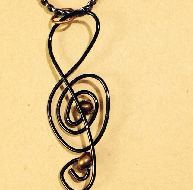 Joy Black wire and seed beed treble clef pendant.  $15 Www.sozojewellerydesigns.com