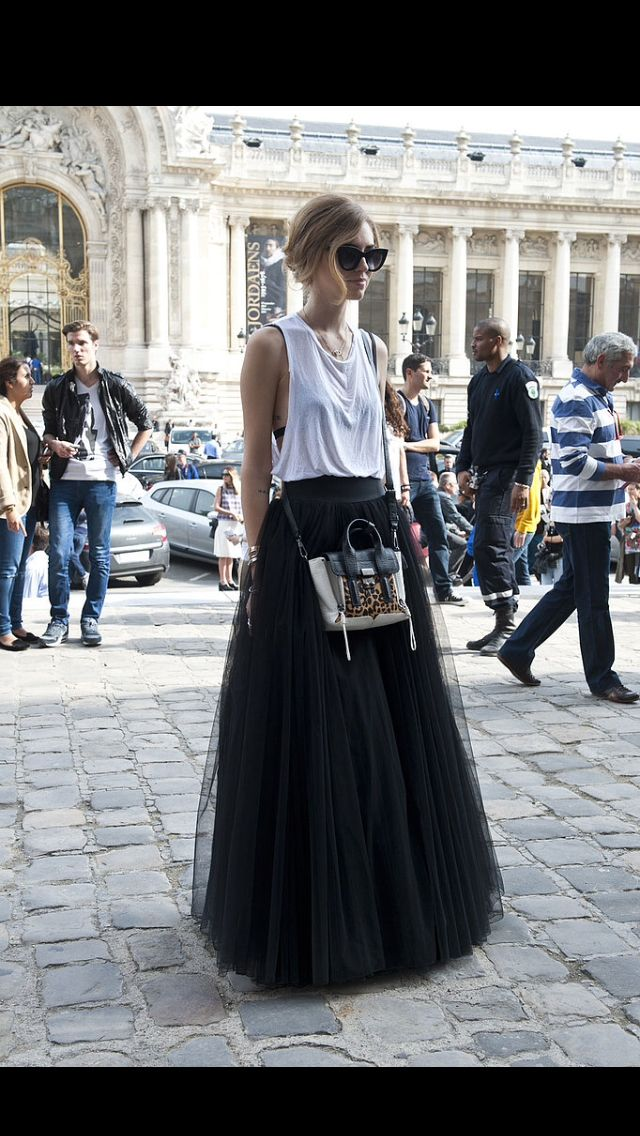 "Paris Fashion Week Fall 2013, had showcased a feminine trend with a twist. Full skirt worn with a casual white t-shirt. Where's the ""love"" button?"