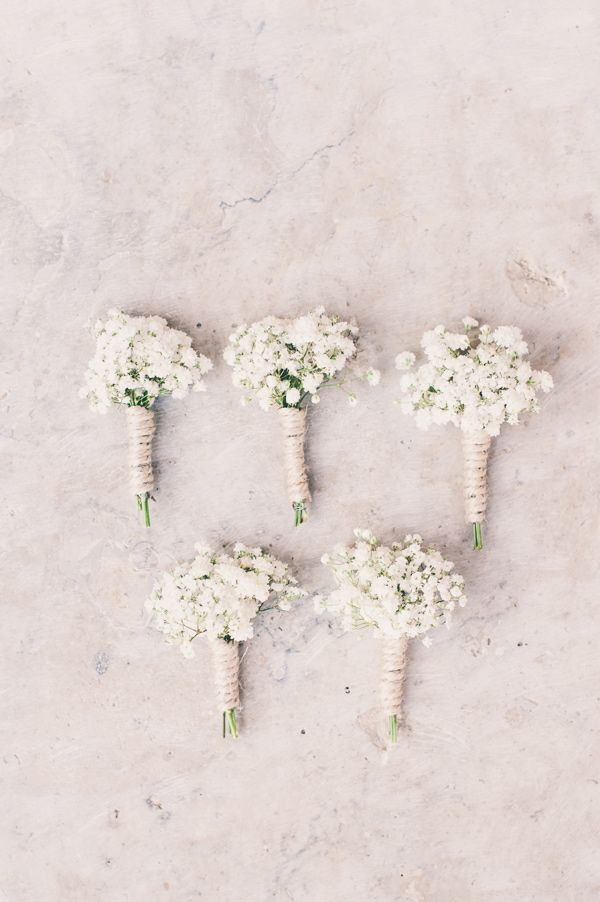 baby's breath boutonnieres, photo by Lisa Poggi http://ruffledblog.com/tuscany-destination-wedding #boutonniere #babysbreath