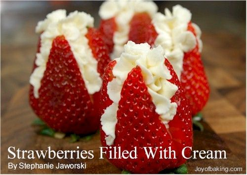 "Pretty!! Strawberries filled with whipped cream. Cut each strawberry into an ""X"" starting at the top and down almost to the bottom. Then fill with whipped cream! Perfect for a valentine party!"