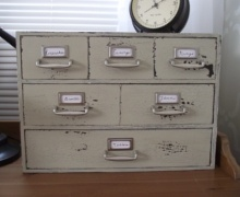 Ikea Moppe drawer hacked to look like old card catalog. I LOVE THIS SO HARD