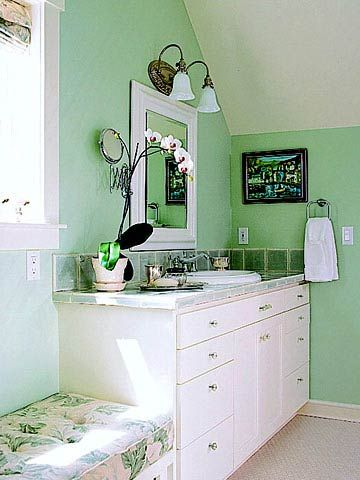 pairing a vibrant hue with white keeps a bathroom airy and fresh mint green