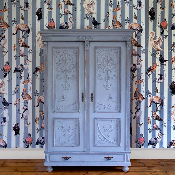 Gorgeous wallpaper from House of Hackney looks great against a traditional wardrobe