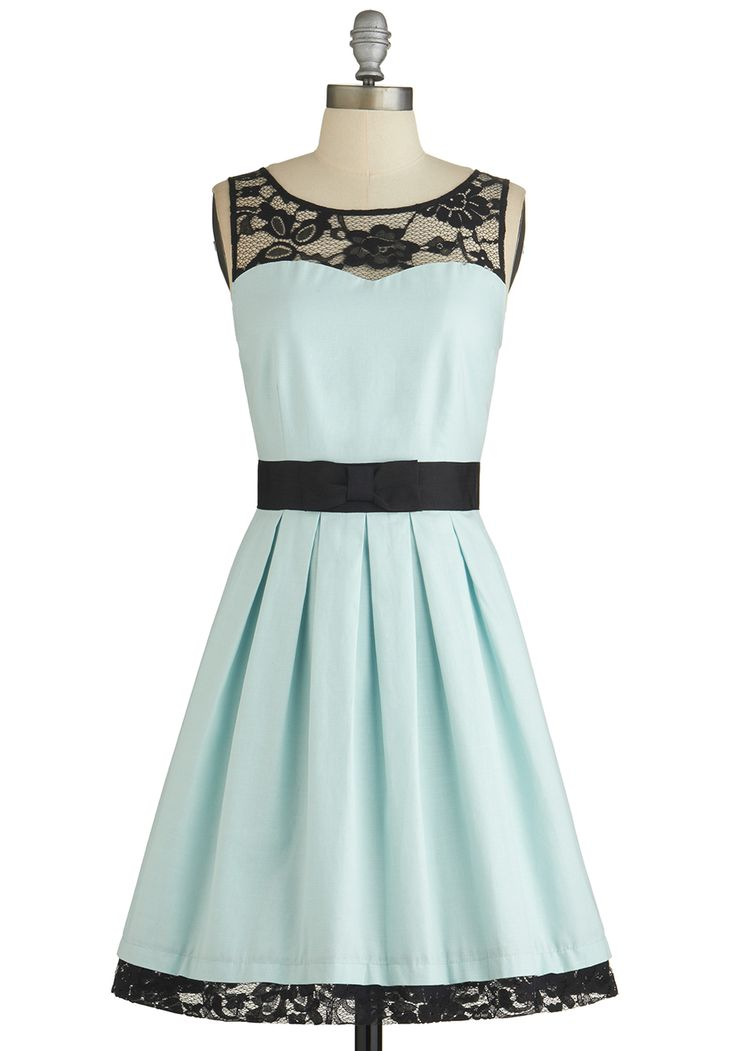 I like the contrast of the light blue and black lace. Paired with black heels or sandals, this would be a great look for an evening or more formal wedding. Soiree Stunner Dress, #ModCloth