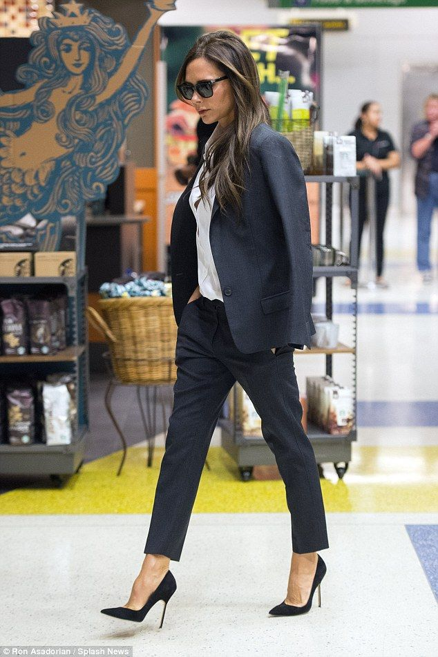 Style for days: Victoria Beckham was unmissable in her fashionable ensemble as she strutted through New York's JFK Airport on Wednesday