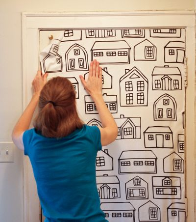 Put fabric on the wall using cornstarch... It's not permanent and leaves nothing on walls-great for renters!