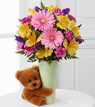 The FTD® Festive Big Hug® Bouquet is a bright and beautiful way to send your warmest wishes and sweet affection.