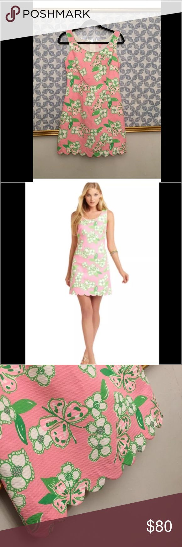 """Lilly Pulitzer Hard To Find Size This style was crazy popular and sold out quickly!A classic shift in a great print, classic Lilly colors with bows down the back. A slim-fitting cut accentuates your best curves and the scoop neckline will lend you an air of unmatched grace and sophistication. Shift Dress With Scalloped Hem And Bow Back. 19 1/2"""" From Natural Waist To Hem. Wave Jacquard (100% Cotton). Machine Wash Cold. Imported. Item is in excellent pre loved condition :) Lilly Pulitzer…"""