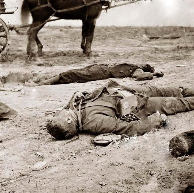 Confederate and Union soldier laying dead, side by side, in a trench. It was made in 1865.    The illustration documents the main eastern theater of war, the siege of Petersburg, June 1864-April 1865.